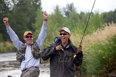 Local fishing guide Dan Vermillion reacts as President Barack Obama hooks a trout on the East Gallatin River near Belgrade, Mont., August 14, 2009.  The President hooked about 6 fish, but did not land any during his first fly fishing outing. (Official White House photo by Pete Souza)
